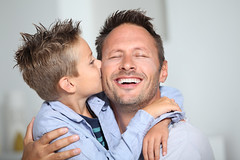 Little bond boy giving a kiss to his dad (jvnz) Tags: boy child little young family kiss kissing embracing hugging hug 7yearsold blond blue eyes tenderness man adult parent father dad daddy happy smiling love singleparent cute caucasian indoors sofa home closeup portrait 40yearsold france