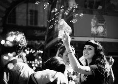 Because I'm happy... (V Photography and Art) Tags: bubbles bokeh monochrome street candid people happypeople happy london