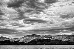 Lake George Remembered (brev99) Tags: dxofilmpack5 d90 landscape clouds cloudscape lakegeorge nikviveza silverefex mountains lake blackandwhite sigma1770os colorefex topazdetail