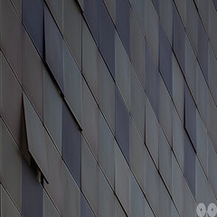 Flakes (occhi0x0cchio) Tags: rough watermark urban purple morning city new architecture wall facade milano aluminum covering