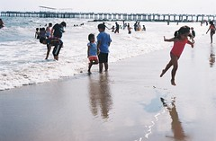 Coney Island Dreaming (jana_markinen) Tags: coney island beach summer newyork brooklyn sun sunshine children play fun happy saturday weekend holiday sand sea reflection people analog analogue fujicolor leica vacation day wind lunapark attraction nyc baywatch quiet chilling eternity sky blue color travel travellling waves wave
