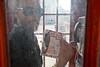 Clerkenwell phonebox (Gary Kinsman) Tags: london ec1 clerkenwell clerkenwellroad canon5d canon1740mmf4l 2011 phonebox redtelephonebox glass pose posed strictvictorianpunishmenttaken people person