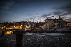 "summer night, Vieux Bassin, dominated by La Lieutenance, against lights and darkening sky, Honfleur, Normandy, France (grumpybaldprof) Tags: honfleur normandy normandie france calvados ""vieuxbassin"" ""oldharbour"" ""quaistecatherine"" ""quaiquarantaine"" quai ""quaistetienne"" ""stecatherine"" ""lalieutenance"" quarantaine water boats sails ships harbour historic old ancient monument picturesque restaurants bars town port colour lights reflection architecture buildings mooring sailing stone collombage halftimbered yachts carousel merrygoround reflections ""waterreflections ""wetreflections""funfair ""eglisesaitecatherine"" night dark gloaming evening nightphotography canon 70d ""canon70d"" sigma 1020 1020mm f456 ""sigma1020mmf456dchsm"" ultrawideangle"