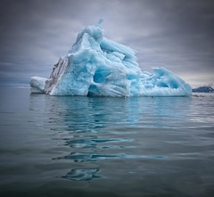 Iceberg Reflections (Chris Willis 10) Tags: spitbergenwedding icebergiceformation ice nature arctic glacier iceberg reflection frozen blue coldtemperature sea icefloe water melting winter snow polarclimate white landscape l