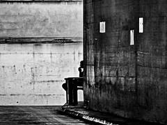 concreted environment (heinzkren) Tags: beton umwelt schwarzweis blackandwhite urban candid biancoetnero noiretblanc monochrome panasonic lumix person people street streetphotography silhouette wien vienna umgebung bank bench