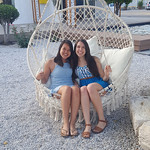Honors students Jessica Grady and Taylor Chock-Wong pose on a chair in Samos during their Greece trip.