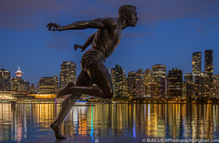 Harry Winston Jerome (westrock-bob) Tags: blue night coalharbour bc winston jerome harrywinstonjerome burrardinlet water runner cuthill park canon britishcolumbia longexposure harry lights 6d summer vancouver copyright statue bobcuthill dark ocean stanleypark outdoors canada eos skyline athlete coalharbor