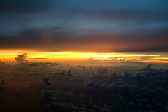 not so tiny dancers on the orange horizon (Jaws300) Tags: coastline coast mountains mountain aloft fromabove airborne philippines sea china southchinasea scenery flying flyingscenery a300600 a300 airbus orangesky storms storm cumulus buildup clouds cloud sun rising sunrise
