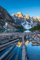 Moraine Lake Logscape (www.mikereidphotography.com) Tags: banff lakelouise lakemoraine peytolake canmore fairmont sunrise sunset landscape lake canada reflection train town mountains peaks alpenglow