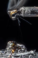Solder Splash (Boba Fett3) Tags: macromondays dripsdropsandsplashes solder metal metallic silver hot melted molten smoke macro closeup upclose canon1dmkiv canon100mmf28