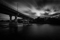 Moving too fast (Rabican7) Tags: bridge cloudscape clouds manchester newhampshire merrimack river downtown longexposure bw monochrome windy lines contrast