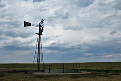 Windmill & Stock Tank (Patricia Henschen) Tags: pawneepioneertrails scenicbyway grassland grasslands pawneenationalgrasslands usda forestservice weld county weldcounty backroads colorado easternplains windmill stocktank clouds autotour route