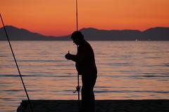 P1000581 (FAJM) Tags: greece syvota sivota thesprotia epirus σύβοτα θεσπρωτία ήπειροσ ελλάδα sunset corfu sea κέρκυρα fisherman fish pier cigarette silhouette