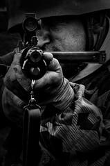 Hands Up (Film Noir) (Nick Biswell) Tags: unitedkingdom england bovingtoncamp bournemouthholiday2016 tankfest2016 sony sonydslra580 sonya580 tamron tamron18270 tamrondt18270mmf3563 soldier paratrooper reenactor reenact reenactment weapon point military gun rifle sights camouflage portrait assault man automatic shoot fg42 fallschirmjäger fallschirmjägergewehr42 monochrome blackandwhite silverefexpro niksoftware