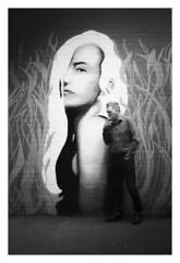 Beady Eye (Dave Fieldhouse Photography) Tags: cigarette smoking portrait outside urban birmingham street streetphotography shadows shade project graffiti art smoker casual digbeth fuji fujifilm fujixpro2 fujinon35mmf2 wwwdavefieldhousephotographycom streetart monochrome blackandwhite tone custardfactory