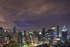 Beyond the clouds (Sumarie Slabber) Tags: lightning clouds cloudy weather nightphotography philippines manila sumarieslabber buildings lights construction skyscrapers epic storm