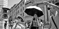 The tourist pose. (Baz 120) Tags: candid candidstreet candidportrait city candidface candidphotography contrast street streetphoto streetcandid streetphotography streetphotograph streetportrait rome roma romepeople romestreets romecandid europe monochrome monotone mono blackandwhite bw noiretblanc urban voightlander voigtlandercolorskopar21mmf40 leicam8 leica life primelens portrait people unposed italy italia girl grittystreetphotography faces decisivemoment strangers