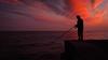 Al amanecer (Carpetovetón) Tags: pescador agua amanecer costa cantábrico caña cielo contraluz colores nubes mar marcantábrico marina nikond200 nikon24mm castrourdiales cantabria españa