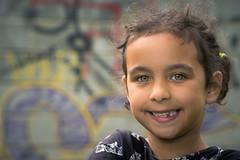 Missing tooth (Lorrainemorris66) Tags: greeneyes cinematic graffiti smile littlegirl missingtooth