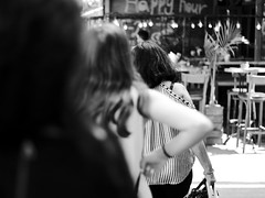 Three Ladies (happy hour) (Ivona & Eli) Tags: orderly row arms hands bar urban dizengoff middleeast israel telaviv sunny passersby city bw monochrome women street