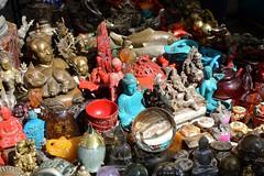 Buddha & Mao? (jjrodriguezphotos) Tags: figurine figurines statue statues buddha buddhastatue buddhafigurine buddhafigurines ganesha mao red teal street streetfair shopping photography photos photo pictures newyorkcity nyc newyork newyorkphotographer nikon nikond7100 d7100 d7100nikon