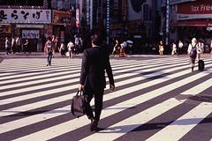 Kabukicho Crossing, Tokyo (benriley80) Tags: shinjuku tokyo japan kabukicho redlight crossing zebra film slide positive e6 minolta alpha5 dynax5 maxxum5 street 35mm streetphotography minoltafilm salaryman suit