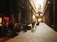 Dinner in Barcelona, Spain (` Toshio ') Tags: toshio barcelona spain spanish gothicquarter street dinner bicycle oldtown europe european europeanunion people cafe restaurant iphone light shadow