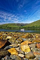 Loch Linnhe. (alan.irons) Tags: lochlinnhe fortwilliam sealoch lowtide sea fault geological greatglenfault rocks scotland argyll calm halcyon serene ecosse bluesky hills boat moored ross tidal shoreline shore stones canon 24105mm