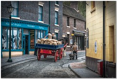 The potato merchant (Hugh Stanton) Tags: horse cart shop wheel barrow appicoftheweek