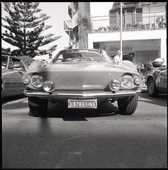 (Fiat 850 Moretti Sportiva) (Robbie McIntosh) Tags: hasselblad hasselblad500cm carlzeissdistagon50mmf4ct 120 mediumformat 6x6 square negative film filmisnotdead moyenformat mittelformat medioformato pellicola selfdevelopment dyi homedevelopment bw blackandwhite monochrome kodakhc110dilb kodak hc110 car classiccar kodaktrix400 kodaktrix trix fiat850morettisportiva fiat850 moretti