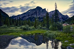Mount Kidd twilight (John Andersen (JPAndersen images)) Tags: alberta boulders clouds kananaskis morning mountains pond silhouettes spring trees