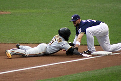 Is He Safe or Is He Out 06222017 (Orange Barn) Tags: baseball majorleaguebaseball milwaukeebrewers pittsburghpirates nightgame milwaukeewisconsin players baseballplayers running stealing makingthetag stealingthird brewers pirates 117picturesin2017 timing