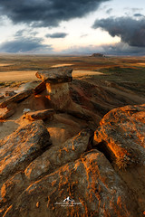Saddle of trolls (Laurent BASTIDE Photographies) Tags: bardenas navarre desert spain espana espagne europe dry landscape canon vanguard storm fine art laurent bastide paysages sunrise light sky clouds
