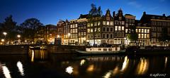Amsterdam. (alamsterdam) Tags: amsterdam prinsengracht evening longexposure reflection canal bridge boats architecture water bikes