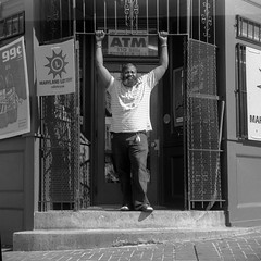 (patrickjoust) Tags: twin lens reflex tlr 120 6x6 medium format black white bw home develop film blancetnoir blancoynegro schwarzundweiss manual focus analog mechanical patrick joust patrickjoust west baltimore maryland md usa us united states north america estados unidos urban street city people person man portrait standing doorway corner store shop
