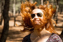 Jumping Around In The Sun (G.Roca) Tags: portrait floating smile lovely daylight woods redhead natural people jumping gorgeous quirky light red madrid sunny summer girl spain funny outdoor forest woman nice outdoors pretty glasses redhair moving hair happy