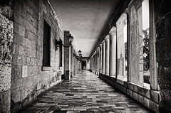 In The End People Are Just Small (Alfred Grupstra) Tags: blackandwhite architecture old street buildingexterior urbanscene italy nopeople history builtstructure outdoors alley city house narrow monochrome facade europe wallbuildingfeature stonematerial corfu