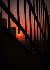 Somewhere in the Far (rizzee) Tags: sunset kolkata evening canon orange stairs photography beautiful above powershot love colourvibes sun buildings city urban