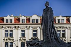 Standing tall (Leaning Ladder) Tags: prague praha czech czechrepublic janhus statue sculpture leaningladder bohemia windows canon 7d