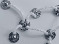 Interconnected (Landanna) Tags: mixedmedia embroidery embroideryonpaper broderi broderipåpapir bordurenoppapier borduren paperart paperwork bullionknot button sample pushbutton 3d