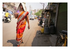 stride out (handheld-films) Tags: india street portrait portraiture woman women female fortitude resilience individual independence resolution striding selfassurance string strength indomitable roleofwomen hyderabad colourful sari indian subcontinent travel