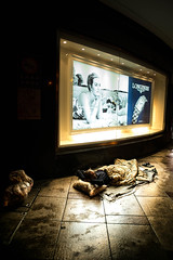Sleeping under Longines eyes (Phg Voyager) Tags: night street homeless urban color add leica mp 24mm phgvoyager shanghai nanjingroad china streetscape urbanscape asia city human sleeping onthefloor pedestrian life photography social man