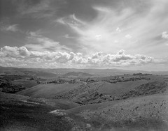 Not far from Volterra, Italy. (wojszyca) Tags: intrepid camera 4x5 largeformat fujinon sw 90mm f8 ilford hp5 hc110 163 gossen lunaprosbc epson v800 redfilter italy tuscany volterra landscape sky clouds