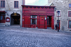 Restaurant in Old Montreal, Canada (` Toshio ') Tags: toshio montreal canada quebec canadian restaurant oldtown street cobblestone history architecture fujixe2 xe2 person winter