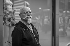 White Beard (Leanne Boulton) Tags: monochrome portrait people urban street candid portraiture streetphotography candidstreetphotography candidportrait streetportrait eyecontact candideyecontact streetlife man male face facial expression eyes look emotion feeling mood piercing beard moustache style stylish tone texture detail depthoffield naturallight outdoor light shade shadow city scene human life living humanity society culture canon canon5d 5dmarkiii 70mm character ef2470mmf28liiusm black white blackwhite bw mono blackandwhite glasgow scotland uk