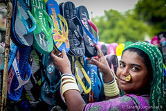 Choice is yours. (Tarang Jagannath) Tags: realpeople roadside woman portrait india indian slippers choice