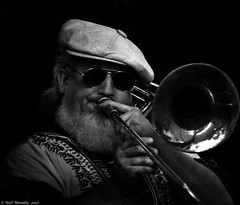 Bold as brass (Neil. Moralee) Tags: neilmoralee usa2017neilmoralee trombone man face portrait candid player musician horn brass blow slide hat dark jazz jaz blues classic honky tonk new orleans louisianna usa beard glasses shades sunnies hippy cap bearded blackbackground shade solo black white mono monochrome neil moralee nikon d7200 contrast band rock trombonist swing sound bw bandw blackandwhite people