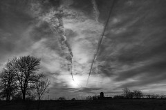 Road Clouds #2 (dharder9475) Tags: 2017 bw blackandwhite clouds condensationtrail contrail dramatic evening gloaming motion privpublic silhouette sunset