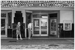Couple at the Strand Theater (Full Circle) Tags: 2017 bw fujixseries fujifilm georgia marietta x100f blackandwhite streetphotography monochrome theater