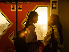 Sky train back home... (Kompakin Borwornpakramil) Tags: fujifilm gfx50s gf3264mmf4rlmwr people students sunset flare streetphotography availablelight moodandatmosphere mediumformat skytrain thailand